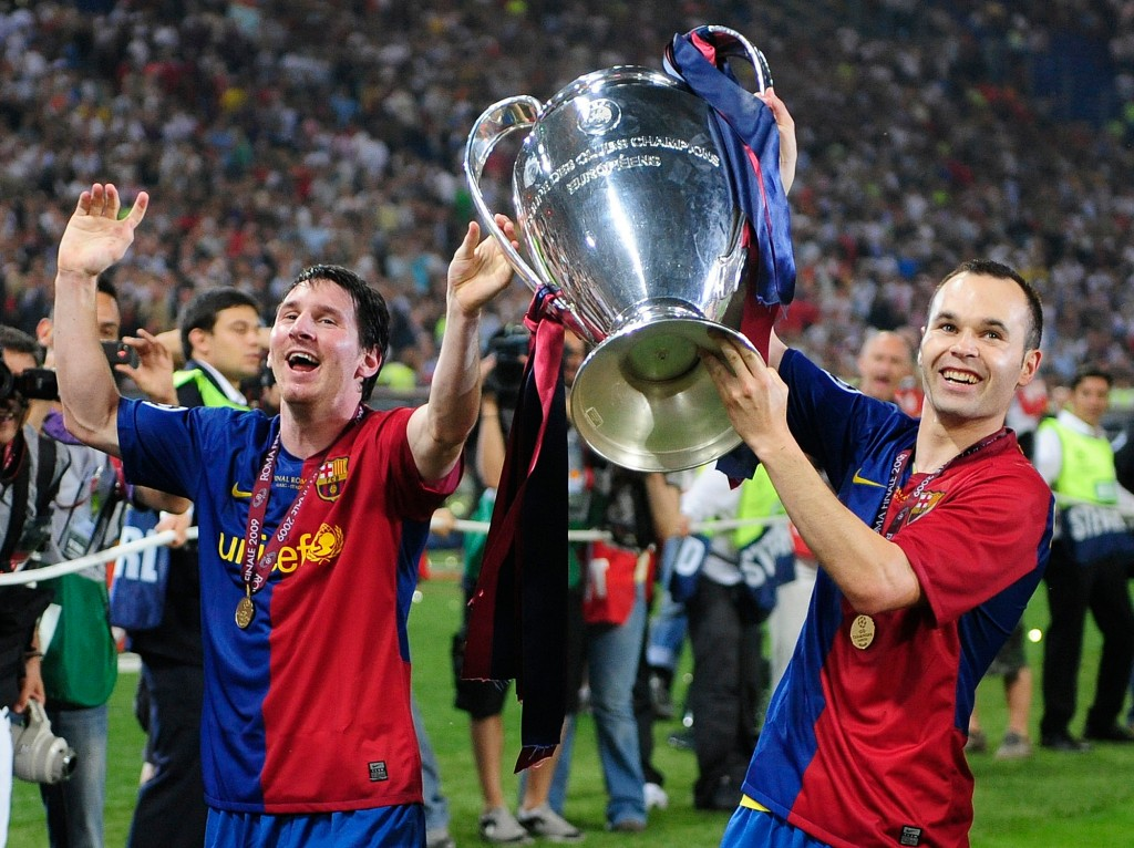 FILE - In this May 27, 2009, file photo, Barcelona's Andres Iniesta, right, and Lionel Messi hold the trophy at the end of the Champions League final ...
