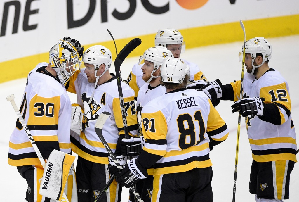 Pittsburgh Penguins goaltender Matt Murray (30) celebrates with right wing Patric Hornqvist (72), of Sweden; right wing Phil Kessel (81); center Domin...