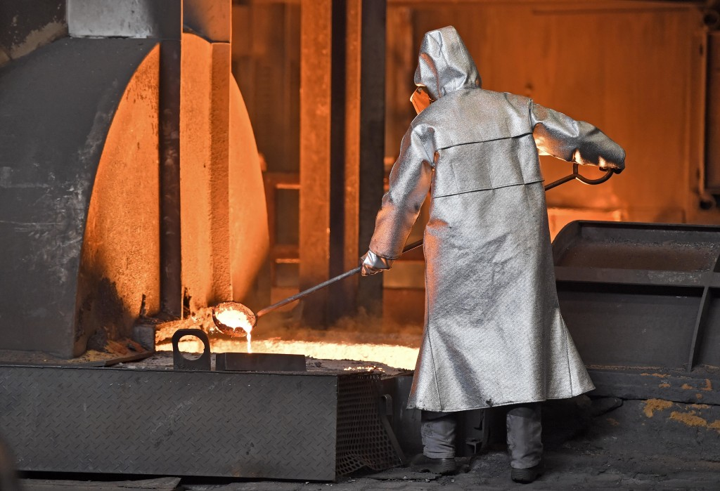 A worker controls iron at the Thyssenkrupp steel factory in Duisburg, Germany, Friday, April 27, 2018. Duisburg is the biggest steel producer site in ...