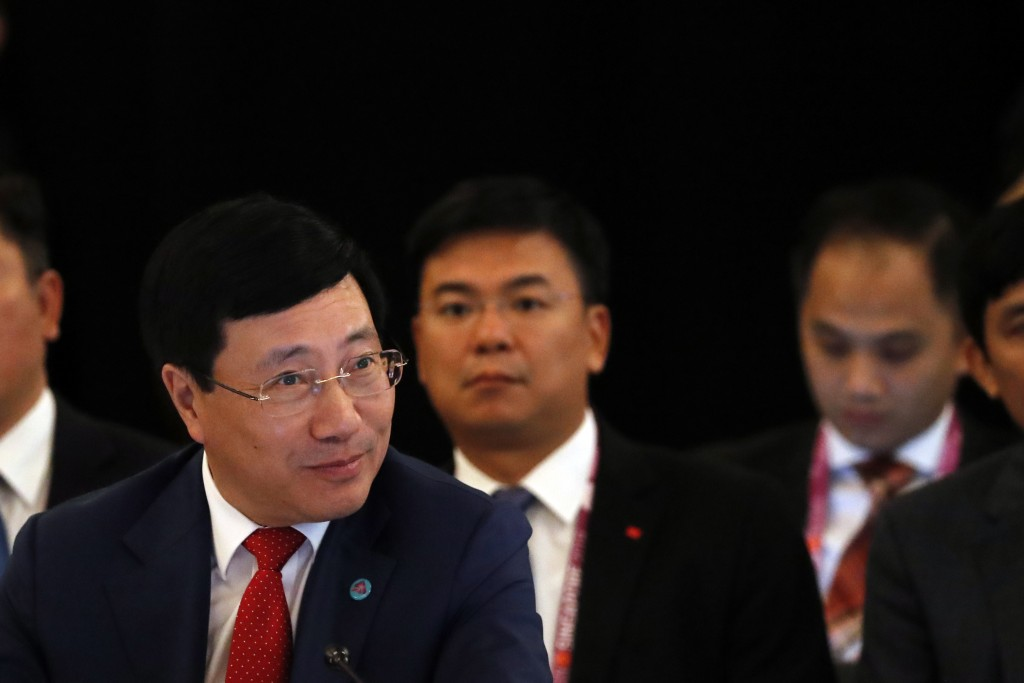 Vietnam's Deputy Prime Minister and Minister of Foreign Affairs, Pham Binh Minh, listens to the opening remarks at the ASEAN Foreign Minister's Meetin...