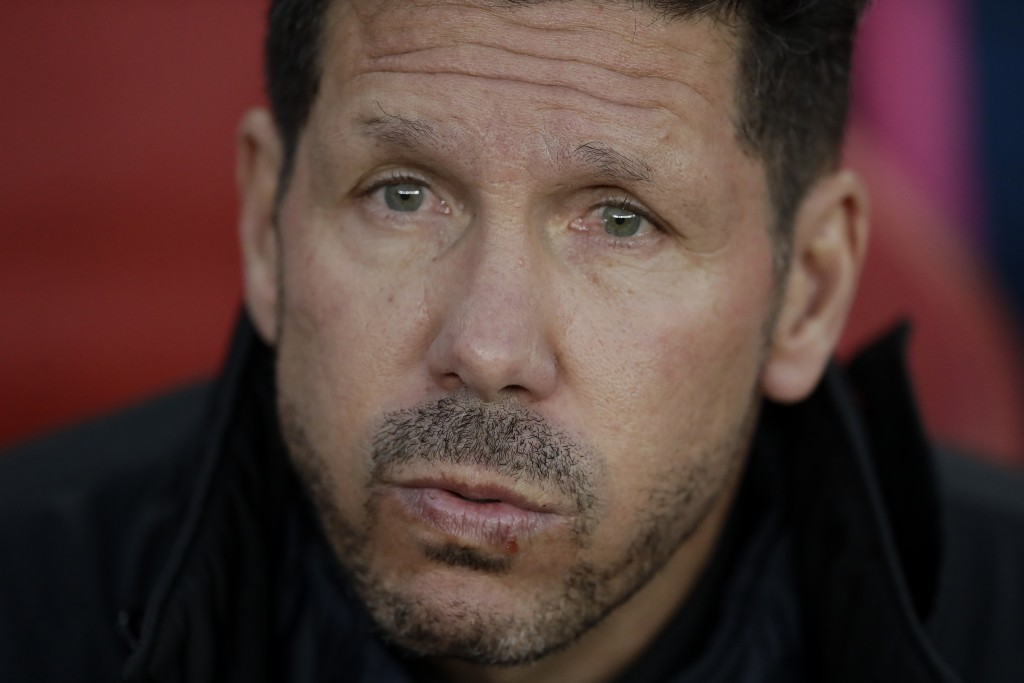 Altetico's head coach Diego Simeone sits on the bench before the Europa League semifinal first leg soccer match between Arsenal FC and Atletico Madrid...
