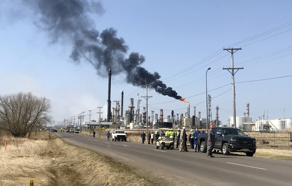 This photo provided by KQDS_FOX21 in Duluth, Minn., shows vehicles and personnel outside the Husky Energy oil refinery Thursday morning, April 26, 201...