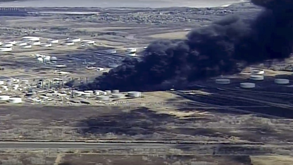 This aerial image from video provided by KSTP-TV in Minneapolis, shows smoke rising from the Husky Energy oil refinery after an explosion and fire Thu...