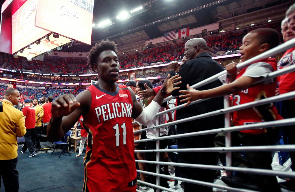 FILE - In this April 21, 2018, file photo, New Orleans Pelicans guard Jrue Holiday greets fans after the Pelicans defeated the Portland Trail Blazers ...