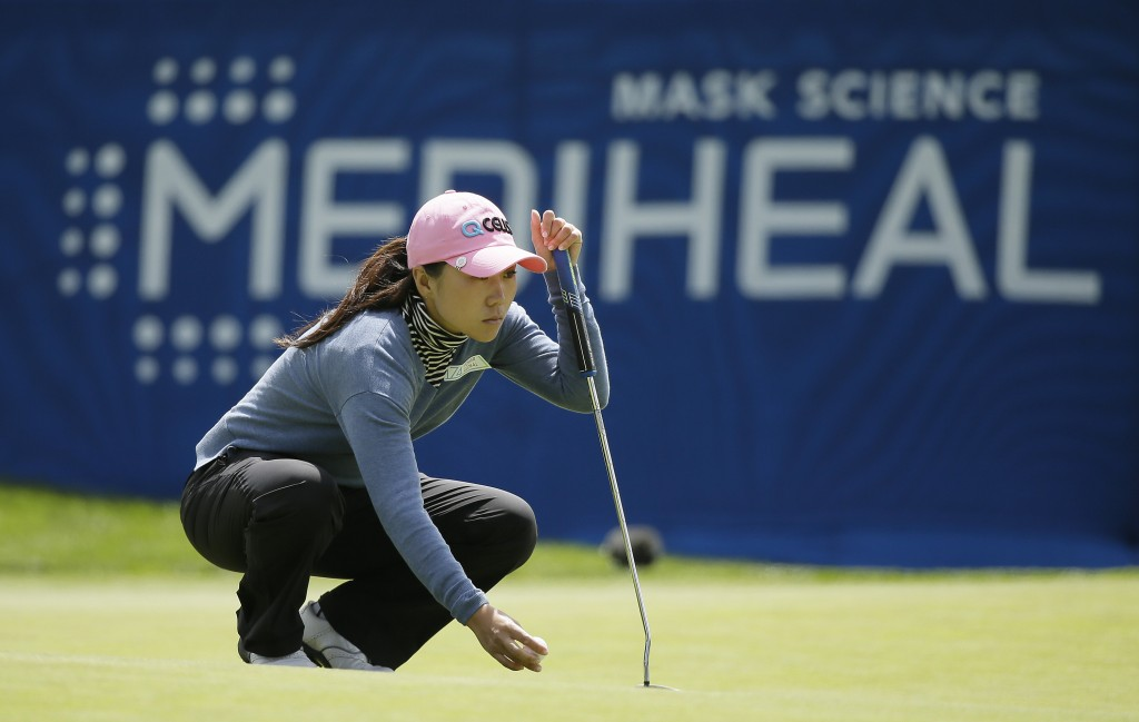 In-Kyung Kim, of South Korea, reads the ninth green of the Lake Merced Golf Club during the first round of the LPGA Mediheal Championship golf tournam...
