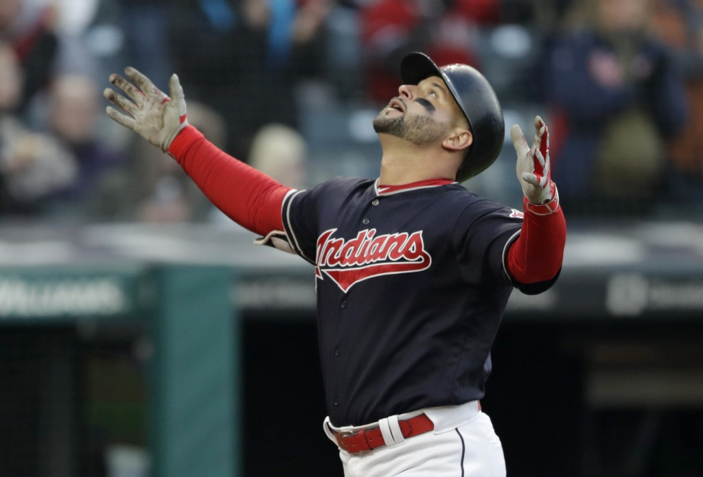 Cleveland Indians' Yonder Alonso celebrates after hitting a two-run home run off Seattle Mariners starting pitcher James Paxton during the sixth innin...