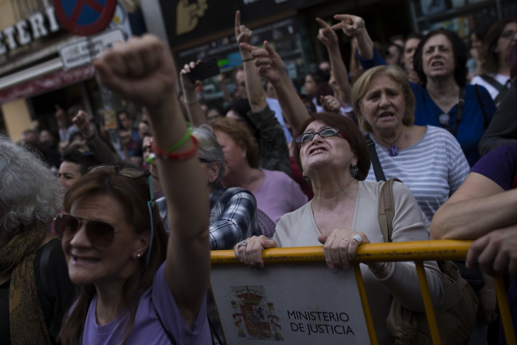 Women shout slogans during a protest outside the Justice Ministry in Madrid, Thursday, April 26, 2018. Women's rights groups are protesting after a no...