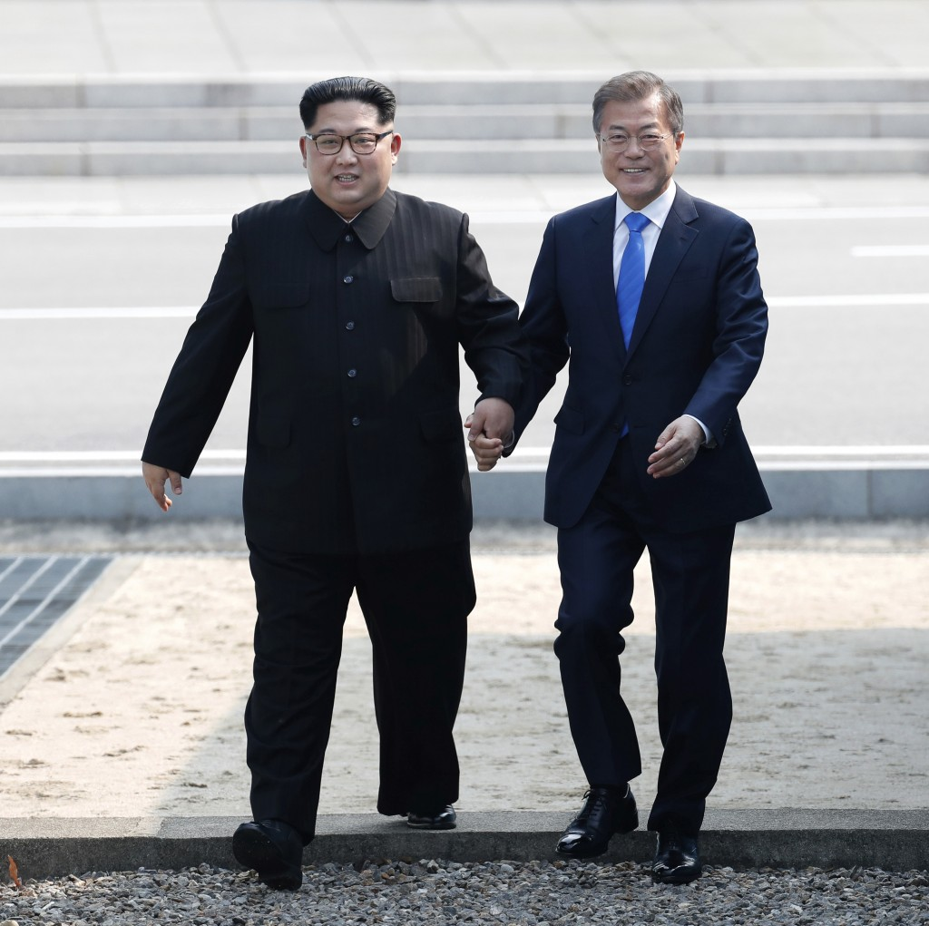 In this Friday, April 27, 2018, file photo, North Korean leader Kim Jong Un, left, and South Korean President Moon Jae-in cross the military demarcati...