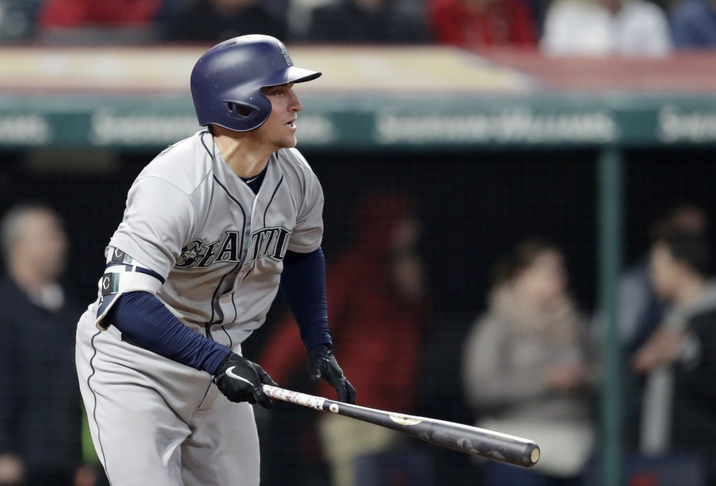 Seattle Mariners' Kyle Seager watches his RBI double off Cleveland Indians relief pitcher Nick Goody during the eighth inning of a baseball game, Thur...