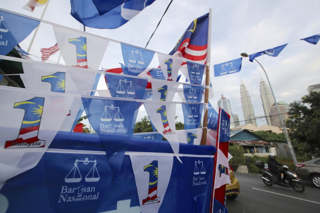 Flags of Malaysia's ruling National Front coalition, or Barisan Nasional, are displayed in Kuala Lumpur, Malaysia, Friday, April 27, 2018. Malaysian g...
