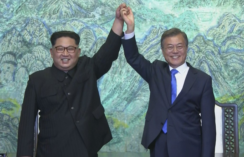 In this image made from video provided by Korea Broadcasting System (KBS),  North Korean leader Kim Jong Un, left, and South Korean President Moon Jae...