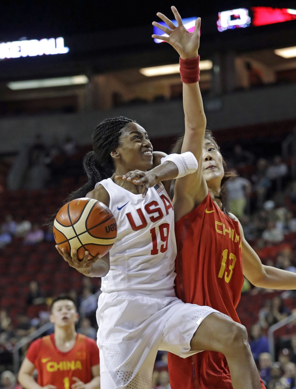 United States' Tiffany Hayes (19) drives as China's Mengran Sun defends during the first half of an exhibition basketball game Thursday, April 26, 201...