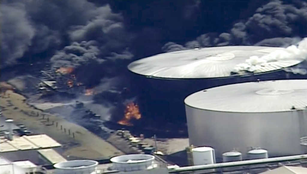 This aerial image from video provided by KSTP-TV in Minneapolis, shows smoke rising from the Husky Energy oil refinery after an explosion Thursday, Ap...