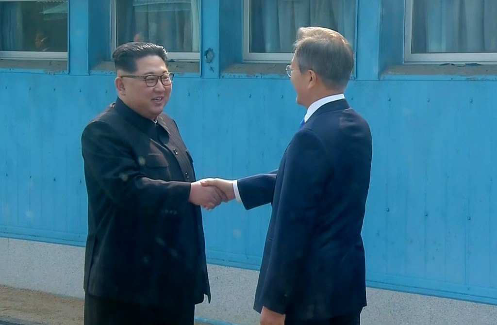 In this image taken from video provided by Korea Broadcasting System (KBS) Friday, April 27, 2018, North Korean leader Kim Jong Un, left,  shakes hand...
