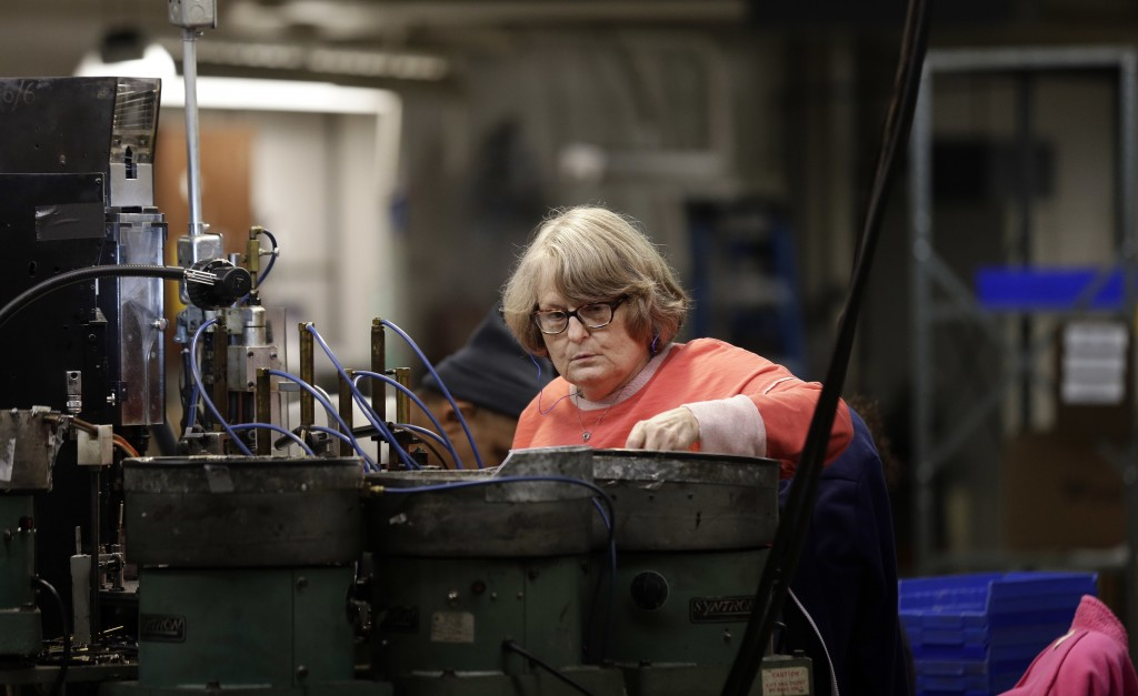 In this Monday, April 16, 2018, photo, employee Lynn Larsen, whom is legally blind, assembles SKILCRAFT pens for the U.S. Government at the Industries...