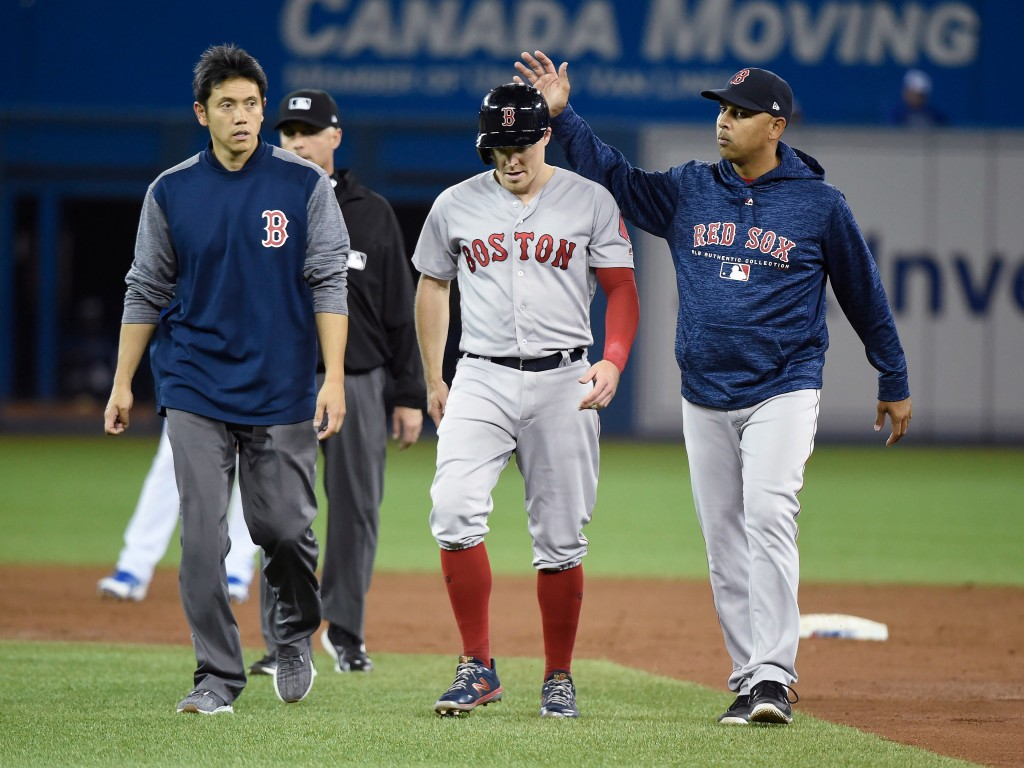 Boston Red Sox second baseman Brock Holt leaves the game with an injury during the third inning of the team's baseball game against the Toronto Blue J...