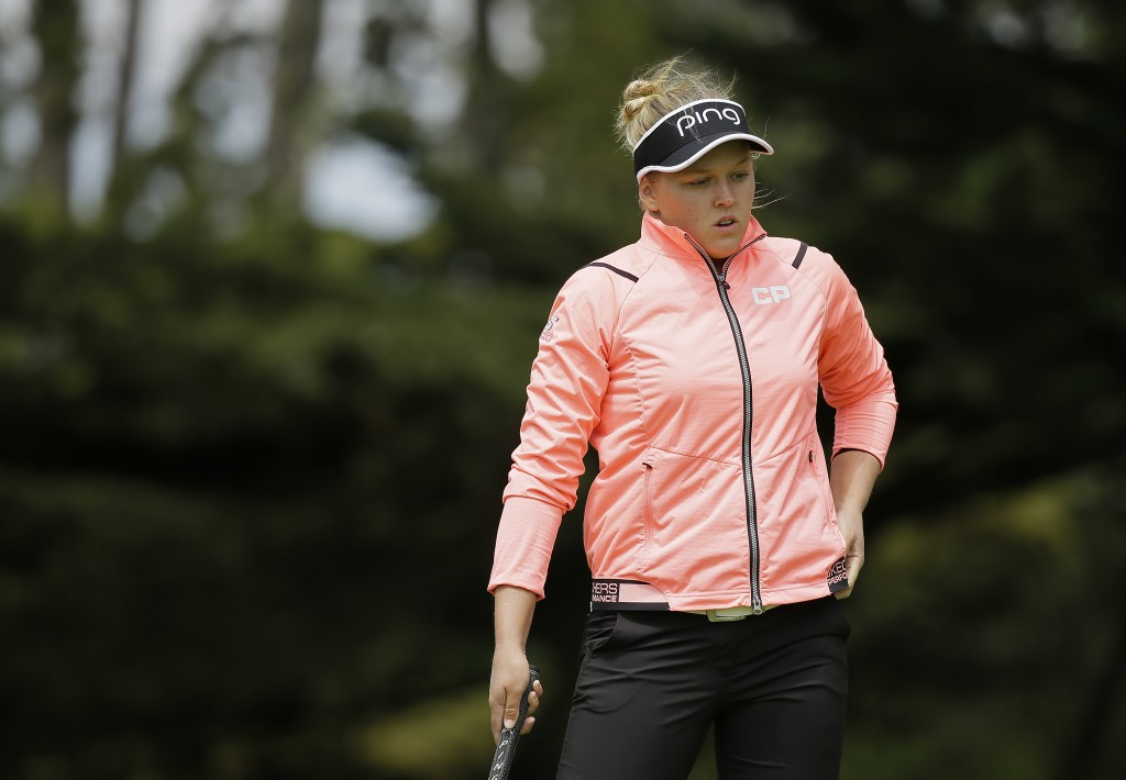 Brooke Henderson, of Canada, reacts after missing a birdie putt on the first green of the Lake Merced Golf Club during the first round of the LPGA Med...