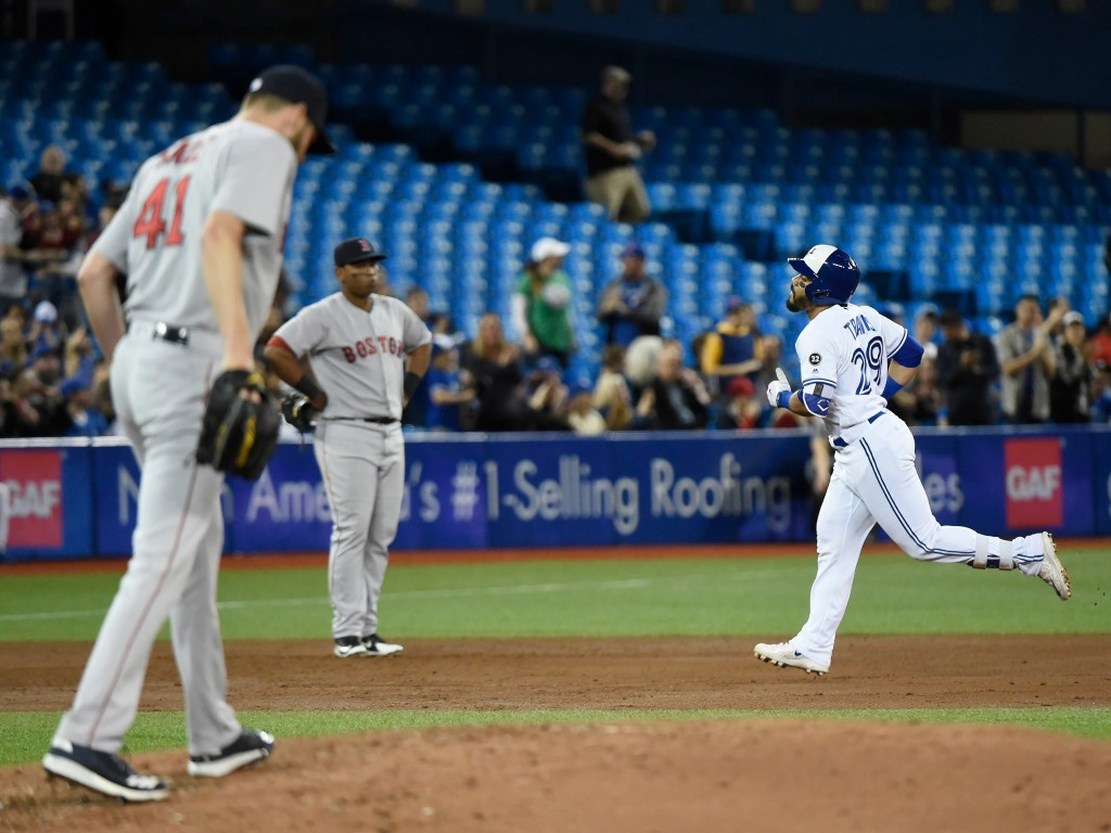 Toronto Blue Jays second baseman Devon Travis rounds the bases after hitting a solo home run off Boston Red Sox starting pitcher Chris Sale (41) durin...
