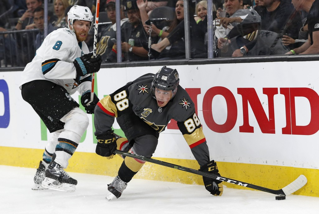 Vegas Golden Knights defenseman Nate Schmidt (88) vies for the puck in front of San Jose Sharks center Joe Pavelski (8) during the third period of Gam...