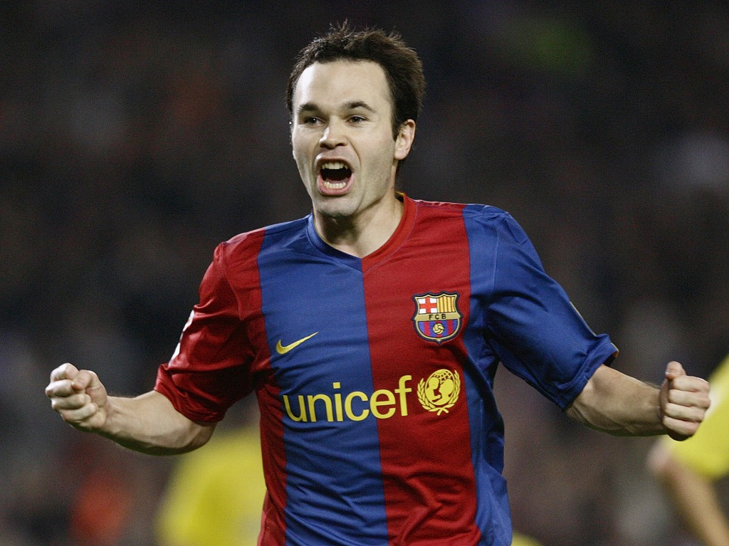 FILE - In this Saturday, Nov. 25, 2006 file photo FC Barcelona player Andres Iniesta celebrates his goal against Villarreal during his Spanish League ...