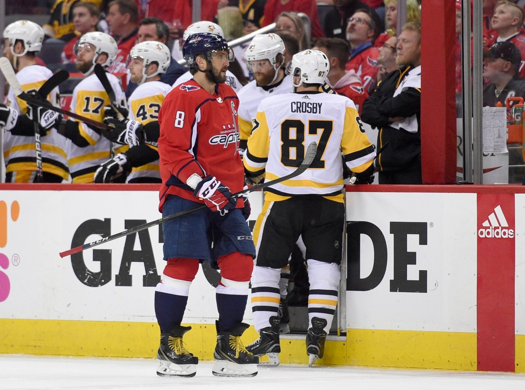 Washington Capitals left wing Alex Ovechkin (8), of Russia, skates next to Pittsburgh Penguins center Sidney Crosby (87) during the first period in Ga...