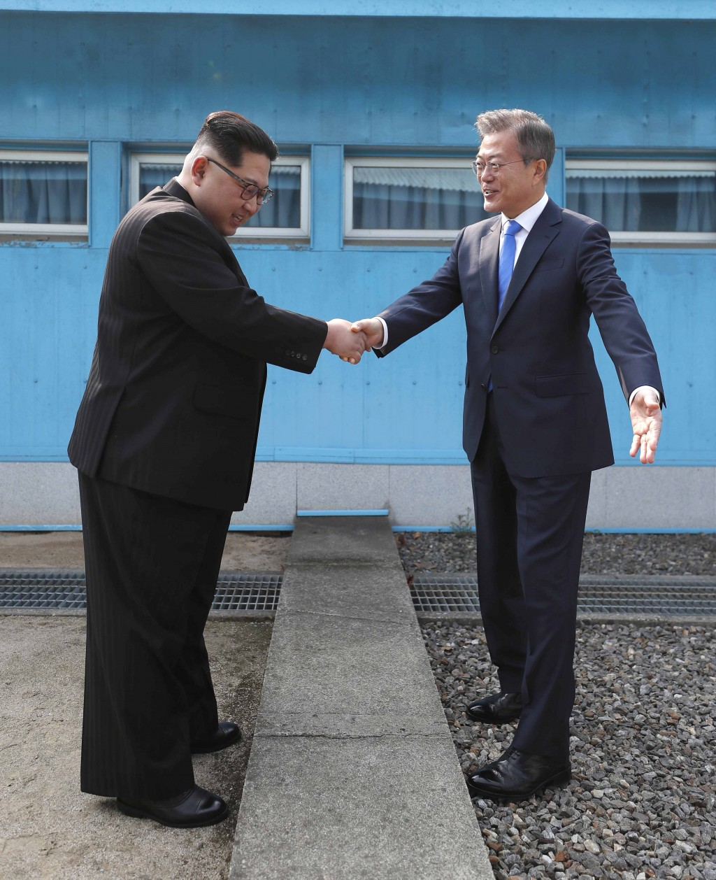 In this Friday, April 27, 2018, file photo, North Korean leader Kim Jong Un, left, shakes hands with South Korean President Moon Jae-in over the milit...