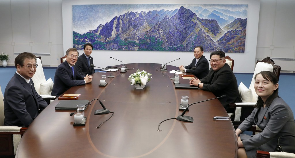North Korean leader Kim Jong Un, center right, and South Korean President Moon Jae-in, center left, pose for the media during a meeting at the border ...