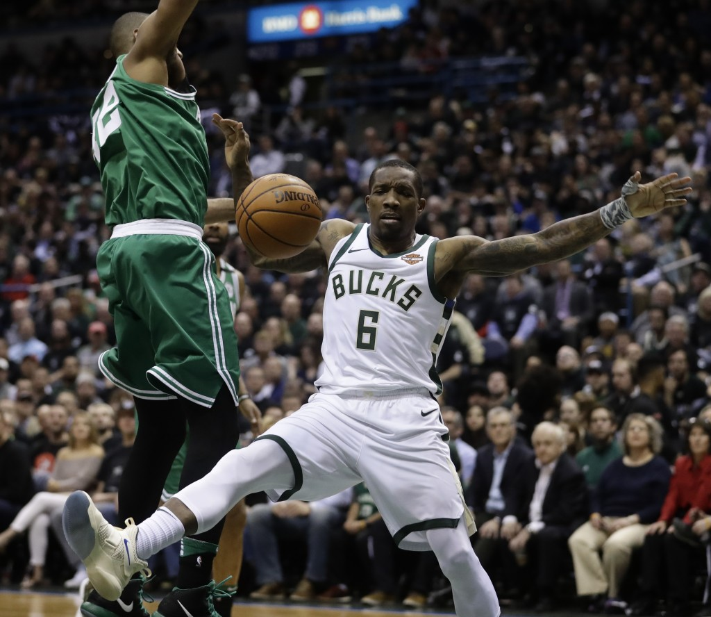 Milwaukee Bucks' Eric Bledsoe is fouled during the first half of Game 6 of an NBA basketball first-round playoff series against the Boston Celtics Thu...