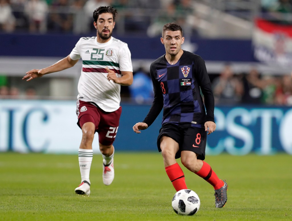FILE - In this photo taken on Tuesday, March 27, 2018, Croatia midfielder Mateo Kovacic makes a pass under pressure from Mexico midfielder Rodolfo Piz...