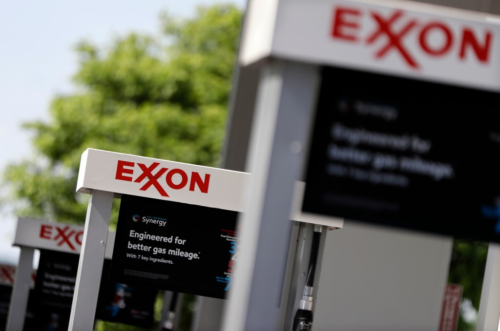 FILE - This April 25, 2017, file photo, shows Exxon service station signs in Nashville, Tenn. Exxon Mobil Corp. reports earnings Friday, April 27, 201...