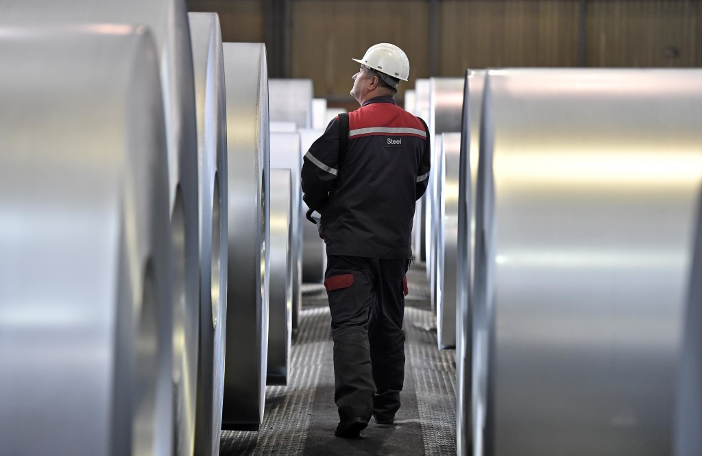 A worker controls steel coils at the thyssenkrupp steel factory in Duisburg, Germany, Friday, April 27, 2018. Duisburg is the biggest steel producer s...