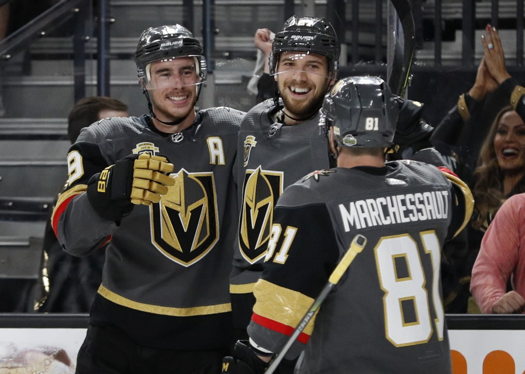 Vegas Golden Knights defenseman Shea Theodore, center, celebrates after scoring against the San Jose Sharks during the second period of Game 1 of an N...
