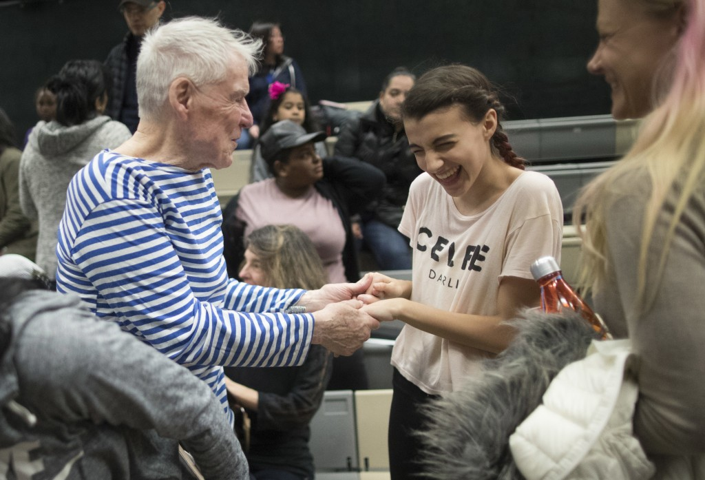 In this Saturday, March 3, 2018 photo, Jacques d'Amboise interacts with a young dancer at the National Dance Institute in New York. The dance school w...