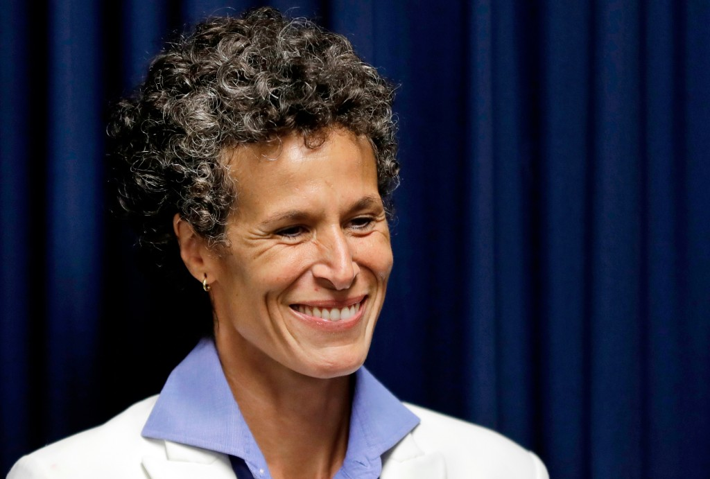Bill Cosby accuser Andrea Constand smiles as she listens during a news conference after Cosby was found guilty in his sexual assault retrial, Thursday...