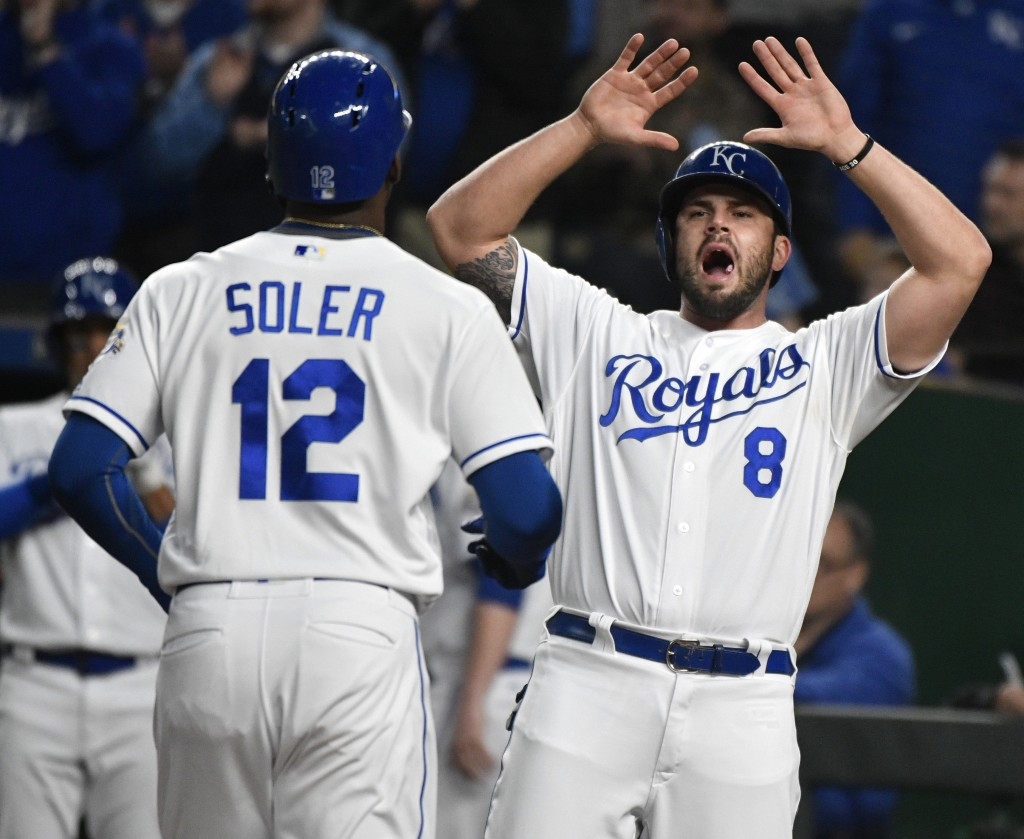 Kansas City Royals' Mike Moustakas (8) prepares to congratulate Jorge Soler (12) after Soler hit a two-run home run in the fourth inning during a base...