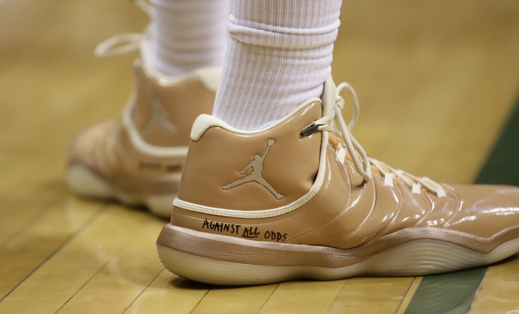 """Milwaukee Bucks' Jabari Parker has """"against all odds"""" written on his shoes during the first half of Game 6 of an NBA basketball first-round playoff se..."""