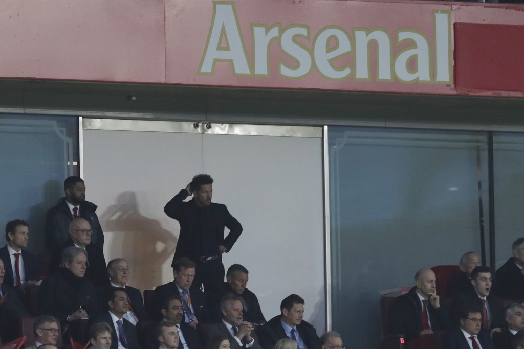 Altetico's head coach Diego Simeone watches his players from the stands during the Europa League semifinal first leg soccer match between Arsenal FC a...