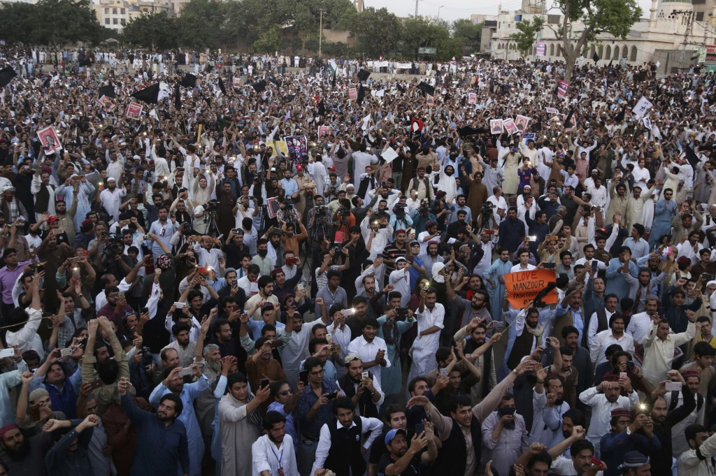 In this Sunday, April 22, 2018 photo, people attend the Pashtun Protection Movement rally in Lahore, Pakistan. A Pakistani rights group in the country...