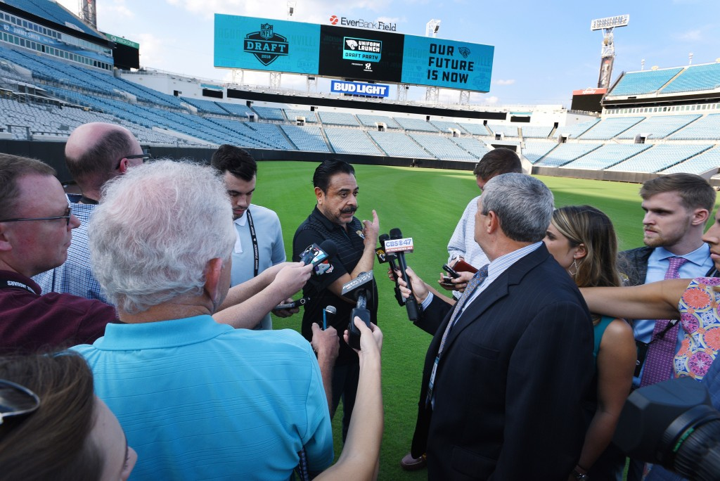 FILE - In this April 26, 2018, file photo, Jacksonville Jaguars owner Shad Khan fields questions from the media on his interest in buying Wembley Stad...