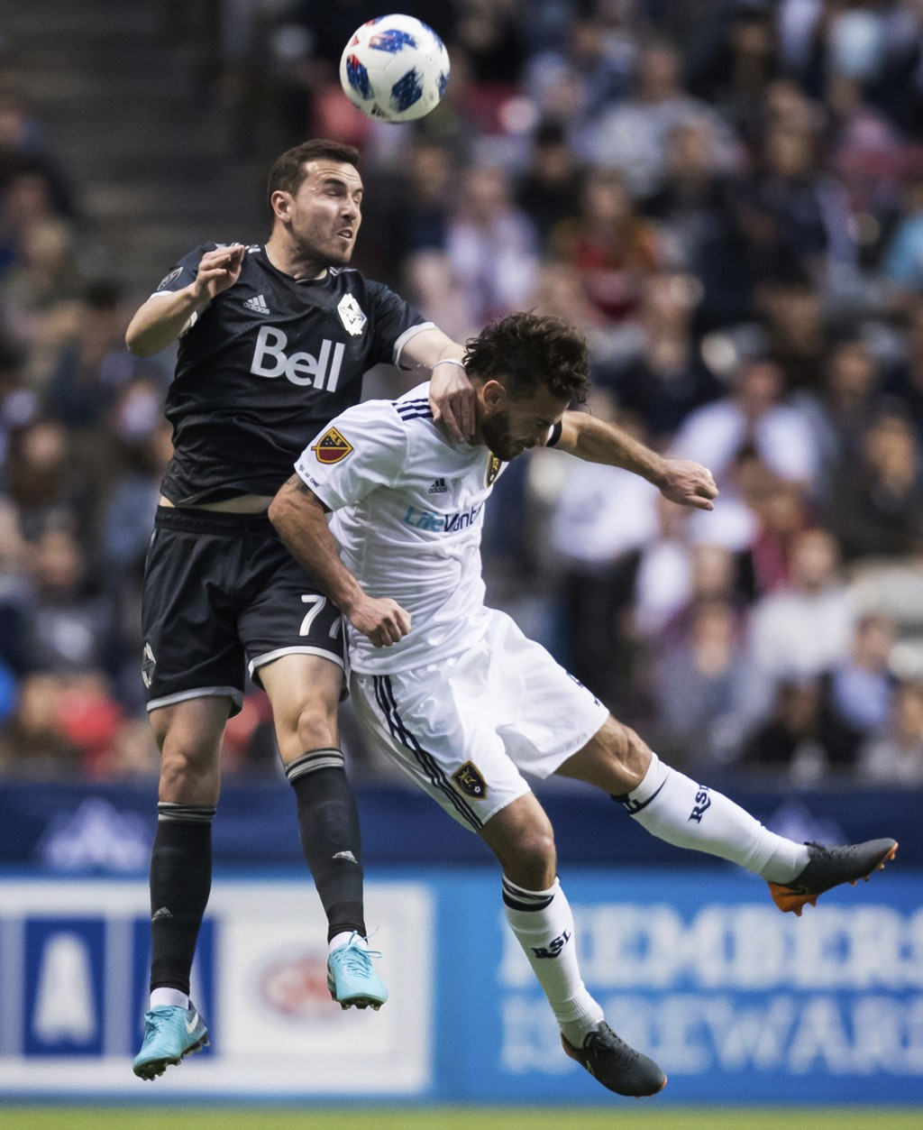 Vancouver Whitecaps' Jordon Mutch, left, and Real Salt Lake's Kyle Beckerman battle for the ball during the first half of an MLS soccer match Friday, ...