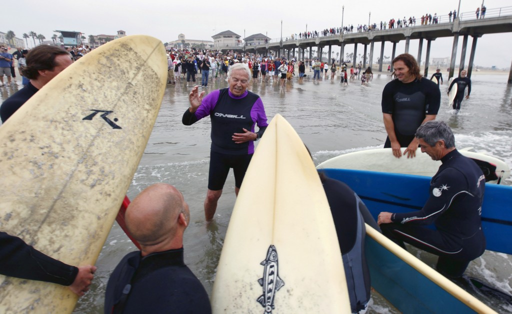 FILE - In this Oct. 3, 2010, file photo, Rev. Christian Mondor, offers a prayer to surfers during the Blessing of the Waves ceremony at the pier in Hu...