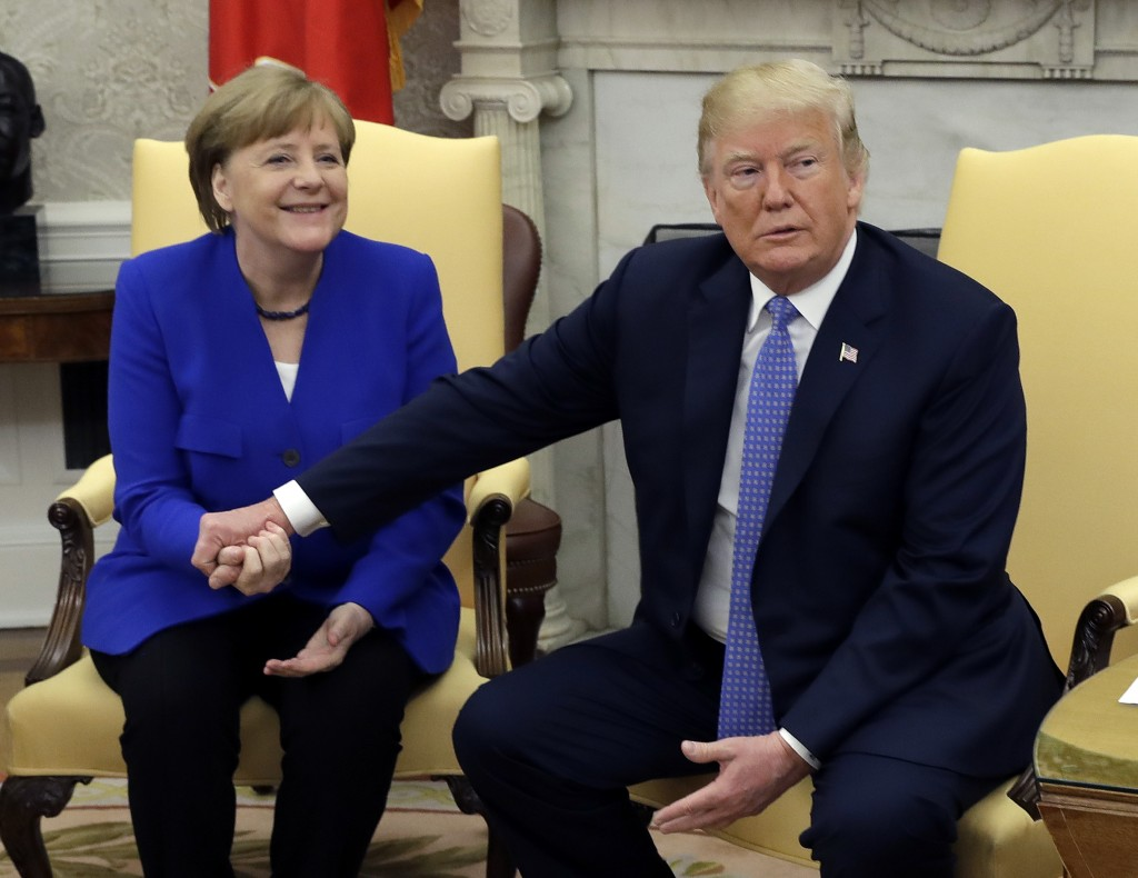 President Donald Trump meets with German Chancellor Angela Merkel in the Oval Office of the White House, Friday, April 27, 2018, in Washington. (AP Ph...