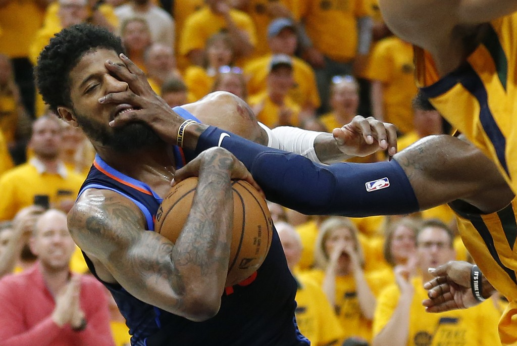Utah Jazz forward Jae Crowder right, fouls Oklahoma City Thunder forward Paul George during the first half of Game 6 in an NBA basketball first-round ...