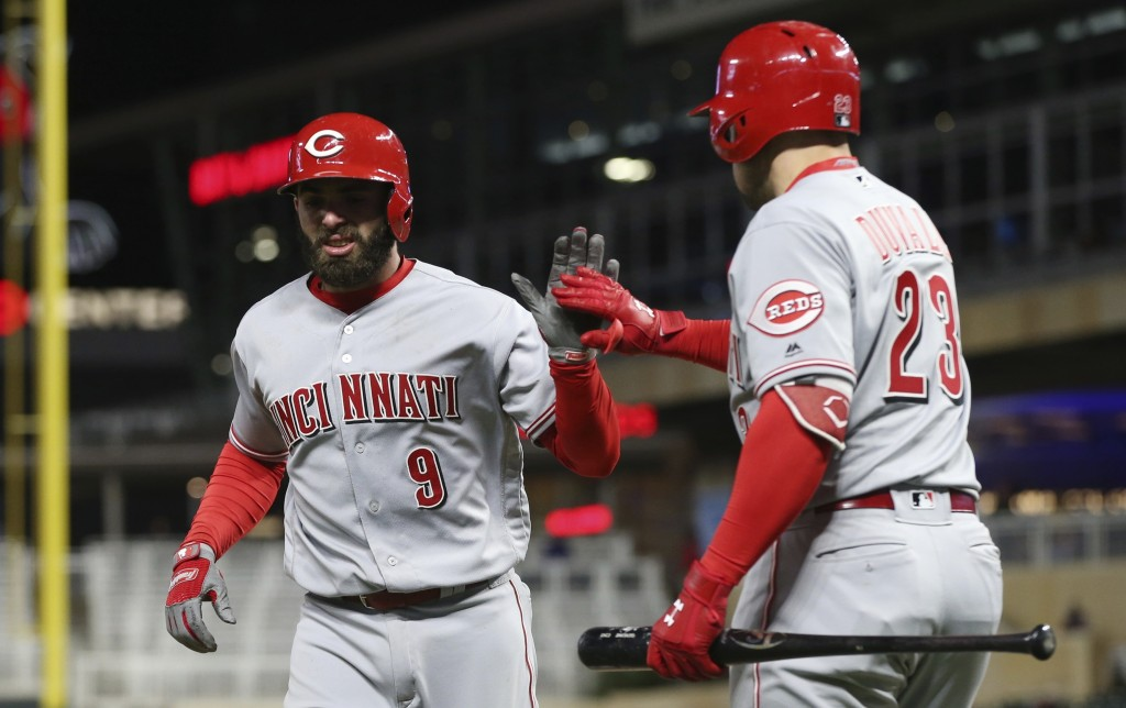 Cincinnati Reds' Jose Peraza, left, is congratulated by Adam Duvall after his solo home run off Minnesota Twins pitcher David Hale during the ninth in...
