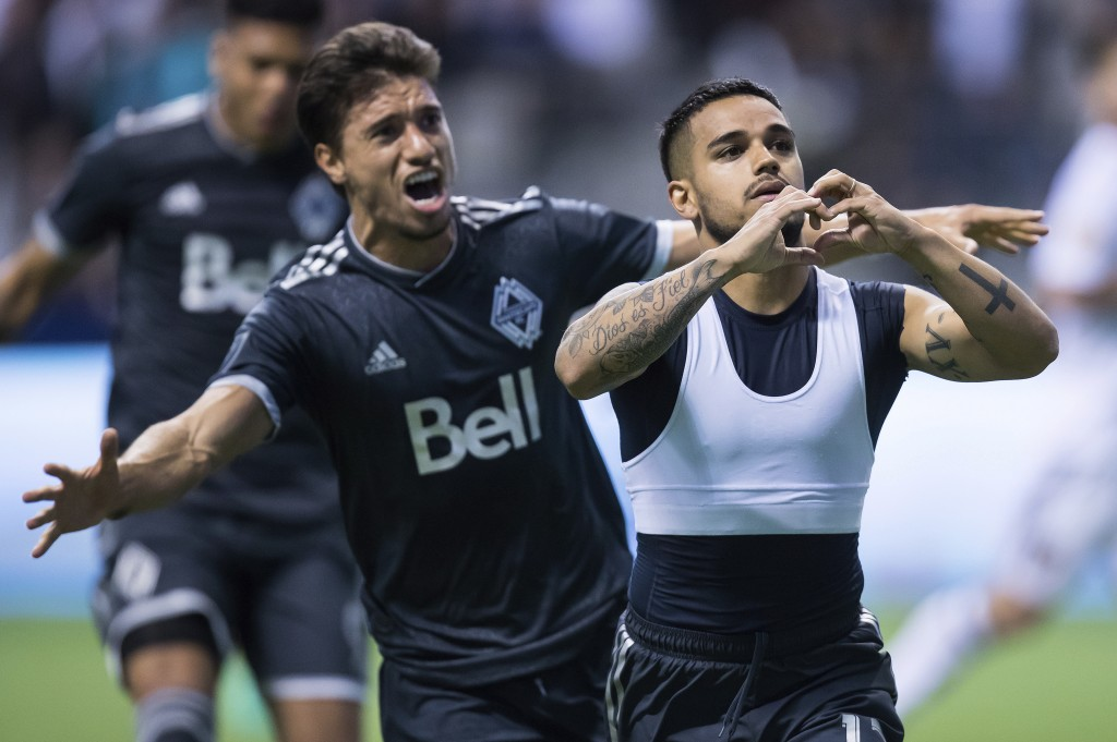Vancouver Whitecaps' Cristian Techera, right, and Nicolas Mezquida celebrate Techera's penalty-kick goal against Real Salt Lake during the second half...