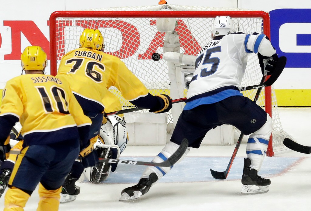 Winnipeg Jets center Paul Stastny (25) scores a goal ahead of Nashville Predators defenseman P.K. Subban (76) during the second period in Game 1 of an...