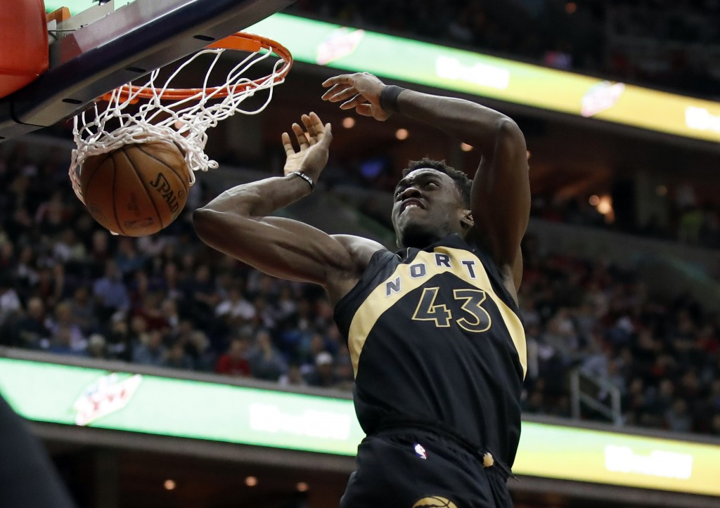 Toronto Raptors forward Pascal Siakam dunks during the first half of Game 6 of the team's NBA basketball first-round playoff series against the Washin...