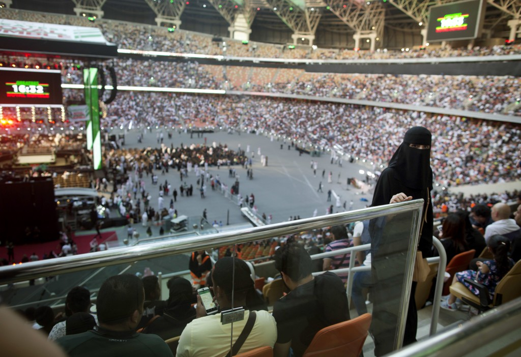 "A woman enters to attend the ""Greatest Royal Rumble"" event in Jiddah, Saudi Arabia, Friday, April 27, 2018. A previous WWE event held in the ultracons..."