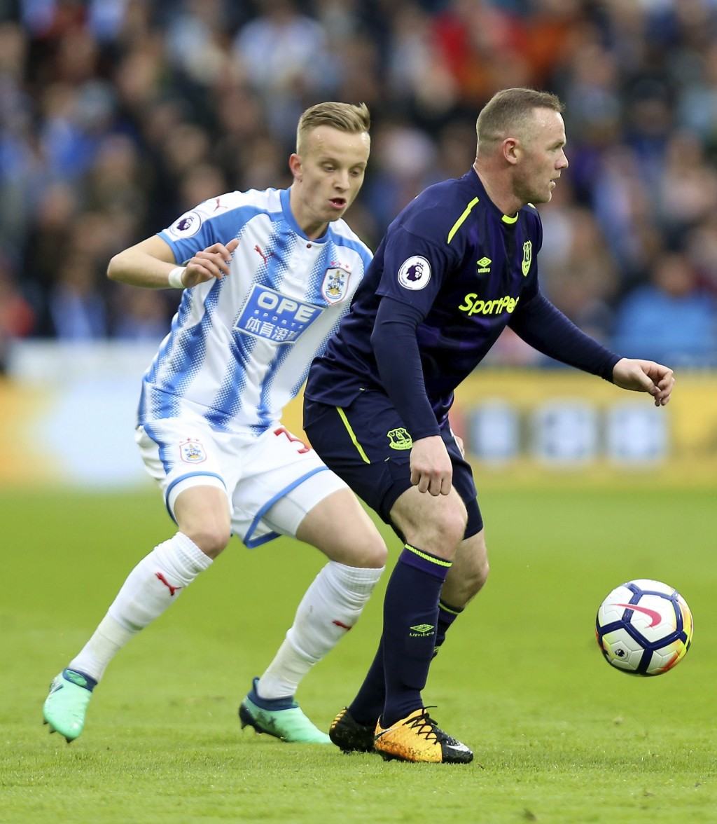 Huddersfield Town's Florent Hadergjonaj, left, and Everton's Wayne Rooney in action during their English Premier League soccer match at the John Smith...