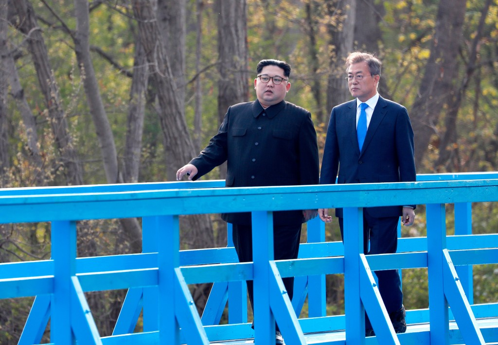 FILE - In this Friday, April 27, 2018, file photo, North Korean leader Kim Jong Un, left, and South Korean President Moon Jae-in talk as they walk on ...